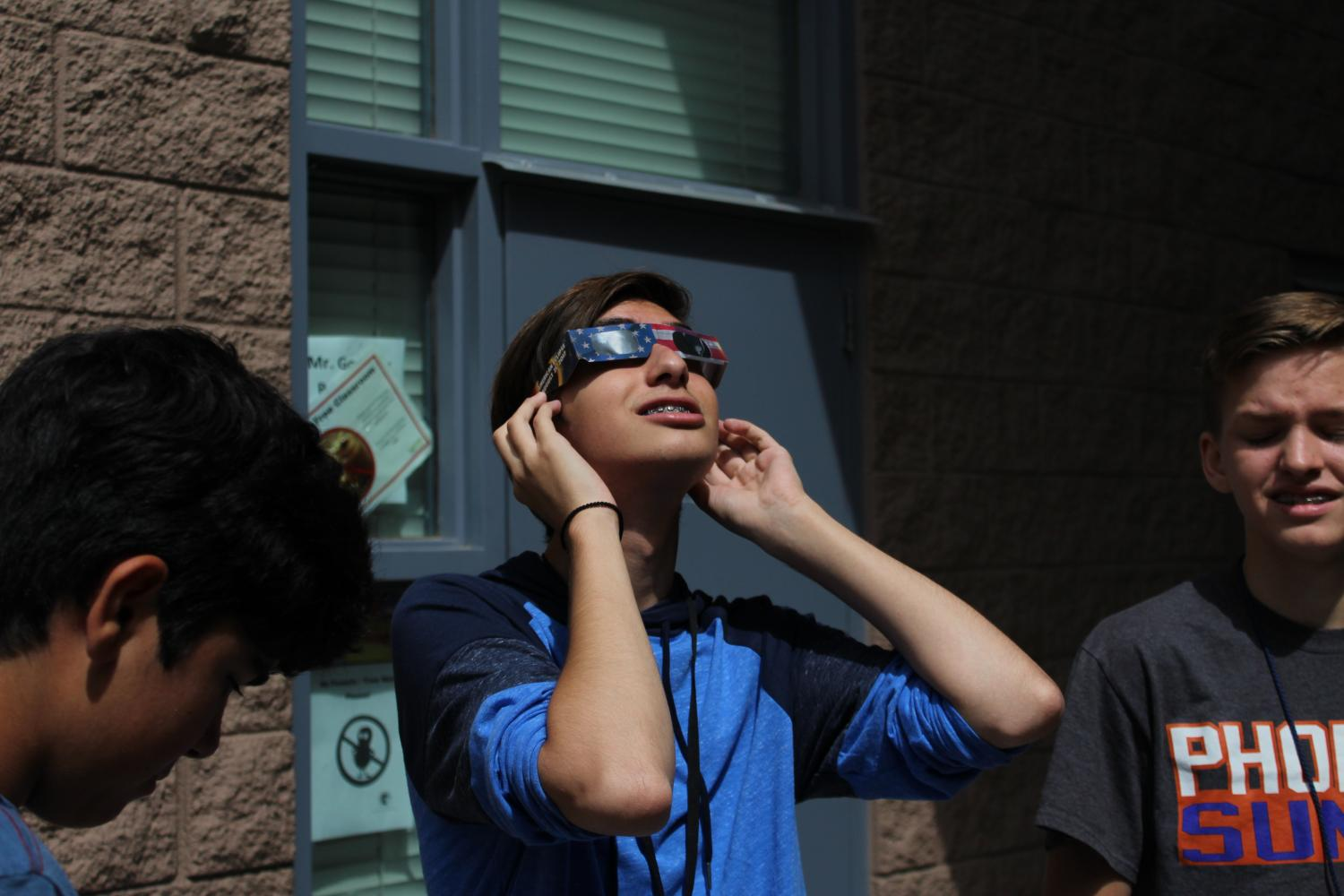 With+NASA+certified+eclipse+glasses%2C+students+safely+viewed+the+rare+phenomenon.+