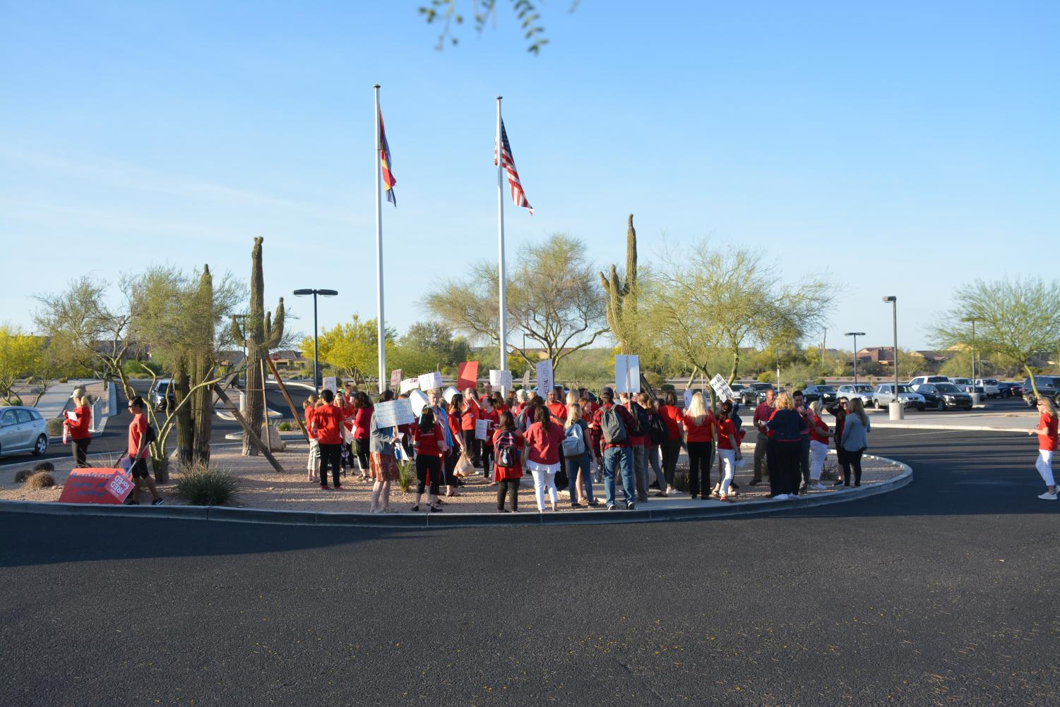 Supporters+of+REDforED+picket+at+front+of+the+school+under+the+flag+before+school+started