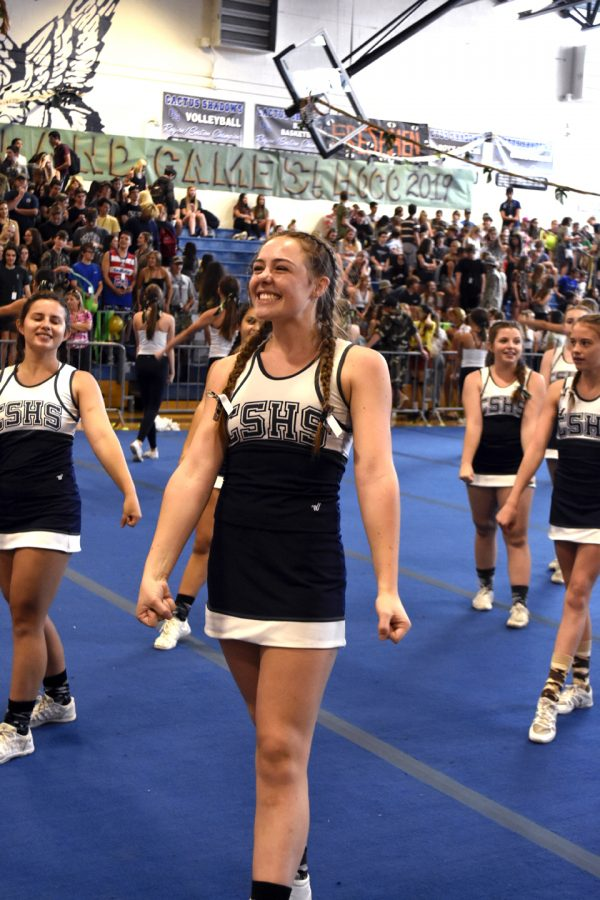 Allie+Thompson+performs+the+cheer+routine+at+the+pep+rally+along+with+her+teammates.+