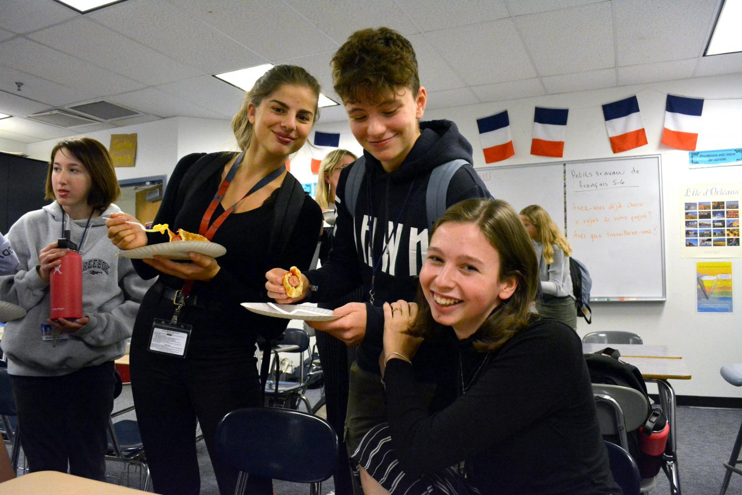 Lilou Arnault, Chloé Flipo, and Romane Blanck, from Lycée Monge, enjoy American cuisine. During French Week, students were given the opportunity to learn about French food and customs.