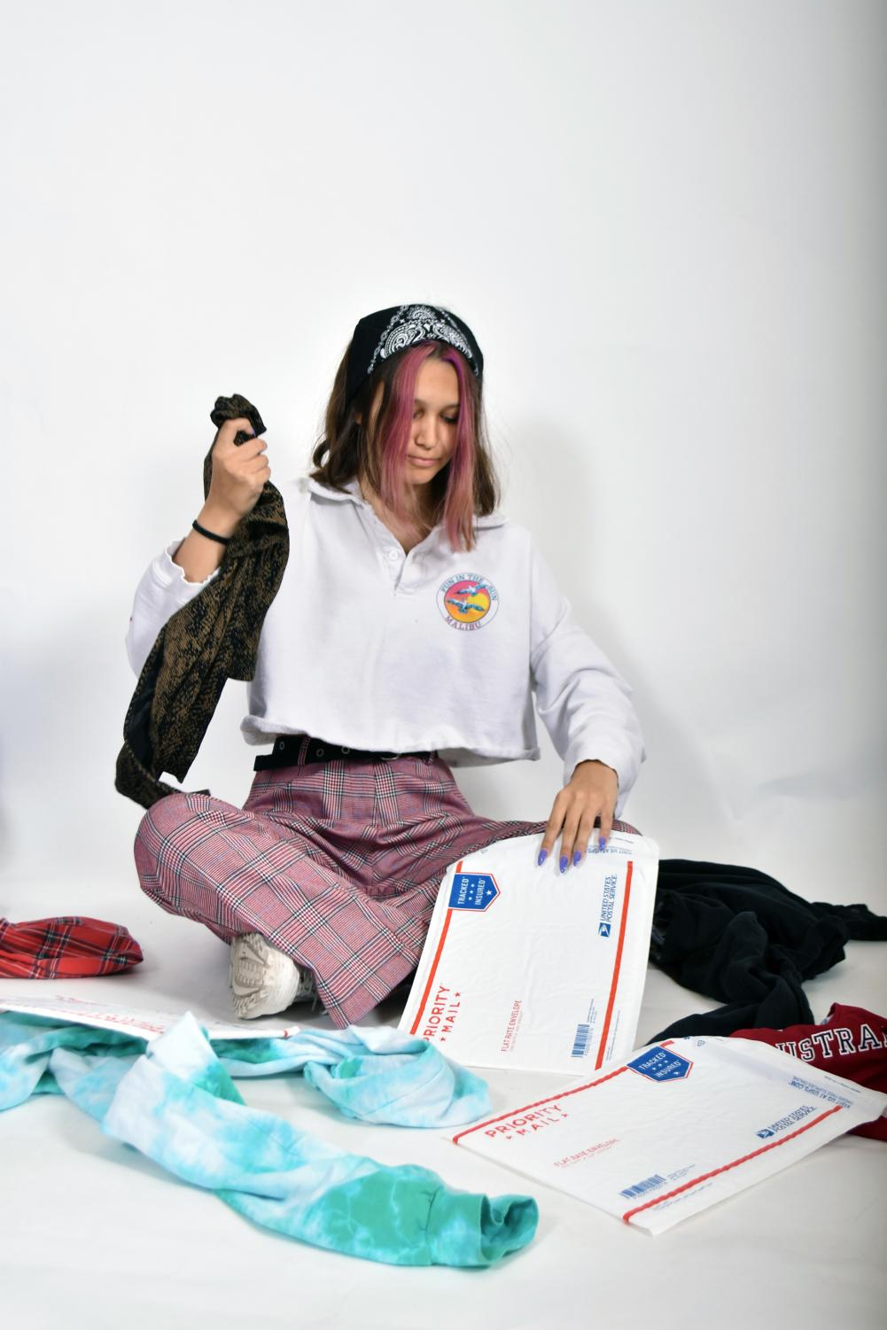 """Packing and shipping clothes is just another part of the job for people who sell their clothes on Depop. Maryn Johnson, a sophomore, is a user of the app where she has sold some of her clothes. """"[Depop] is a really easy way to find clothes for cheap from brands that I wouldn't really buy from usually,"""" said Johnson."""
