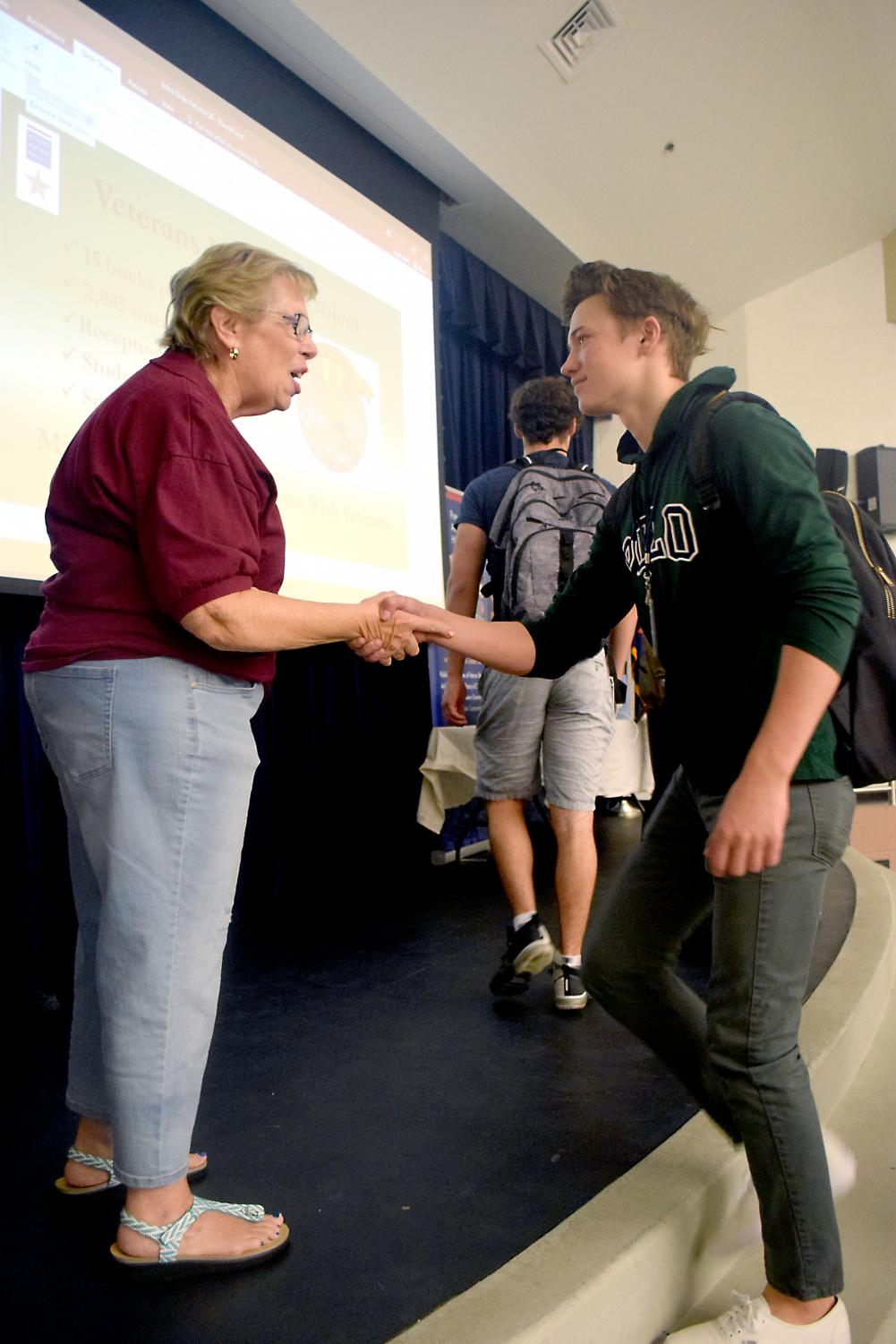 "Cole Hrapczak, a senior,	thanks Martha Kuhns for sharing her stories about the Vietnam War. The Veterans Heritage Project hosts a wide variety of veteran speakers every month. ""Meeting Sally was the highlight of the day for me,"" said Hrapczak."