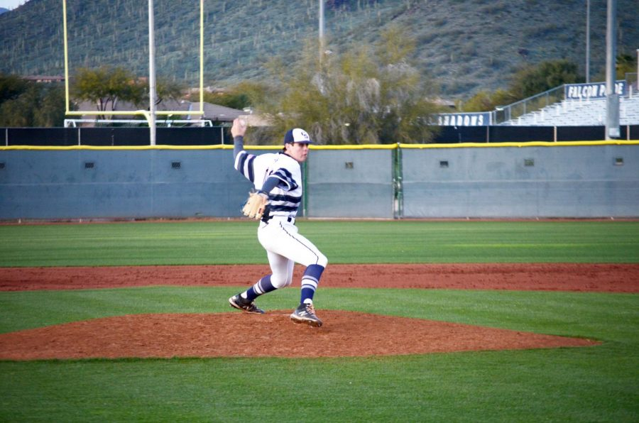 Bennett+Allen%2C+a+junior+takes+the+mound+in+a+varsity+game.+The+Falcons+would+go+on+to+win+the+game+4-3+against+Gilbert+High+School.