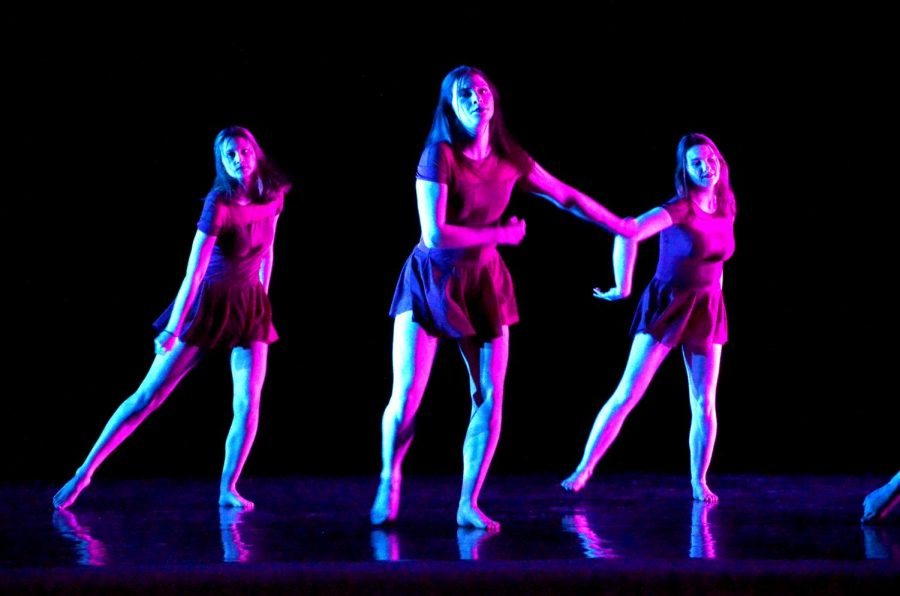 Taking the stage, Maryn Johnson, a sophomore, Ella Skov, and Olivia Tracy, both juniors, perform their dance, Compulsions