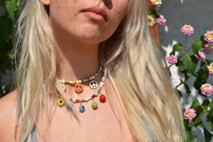 Junior Nia Sogaard models a necklace she made herself