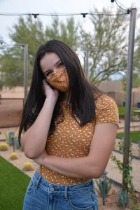Lukha Thirion, a freshman styles her mask by matching the pattern of the mask with a similar shirt.