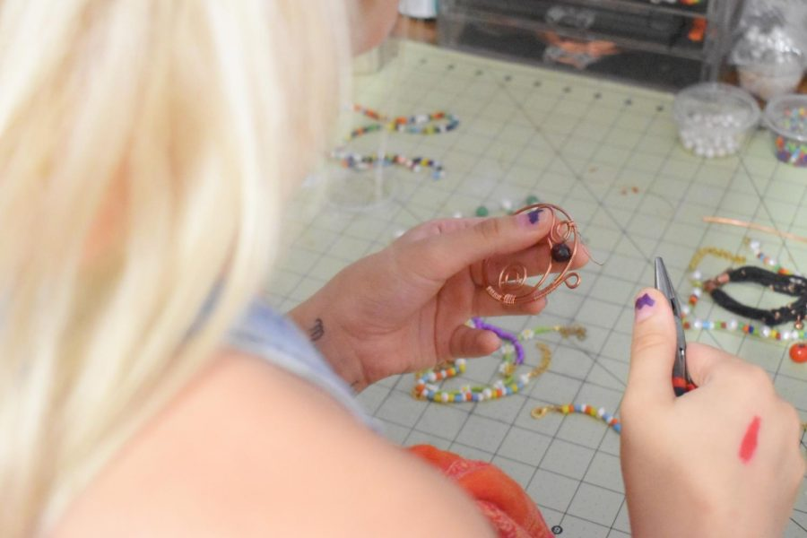 Junior Nia Sogaard makes jewelry using chicken wire and pliers, she also adds decorative charms and beads.