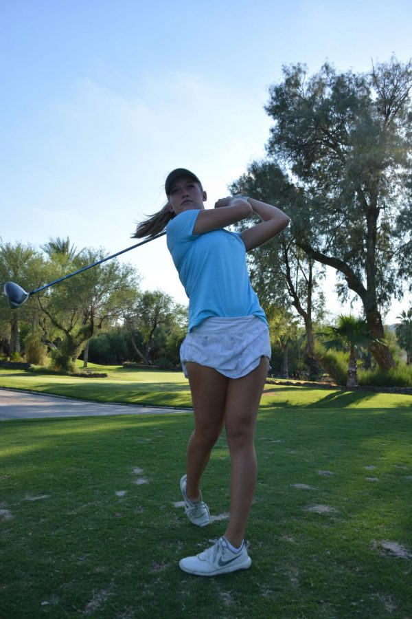 Kylee Loewe, a senior, works on perfecting her swing. Loewe is committed to play D1 college golf at Texas Tech University after graduating.