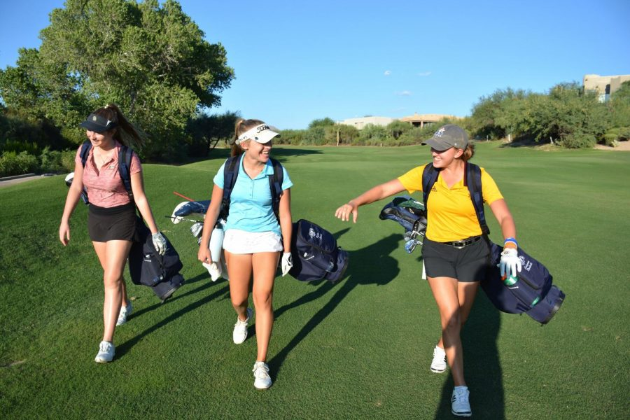 Seniors Shanna Shuckman, Kylee Loewe, and Calynne Rosholt transition from one hole to the next during practice at Rancho Manana Golf Club.