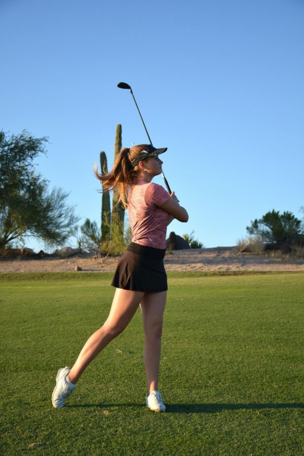 Senior Shanna Shuckman practices her swing before teeing up at practice.