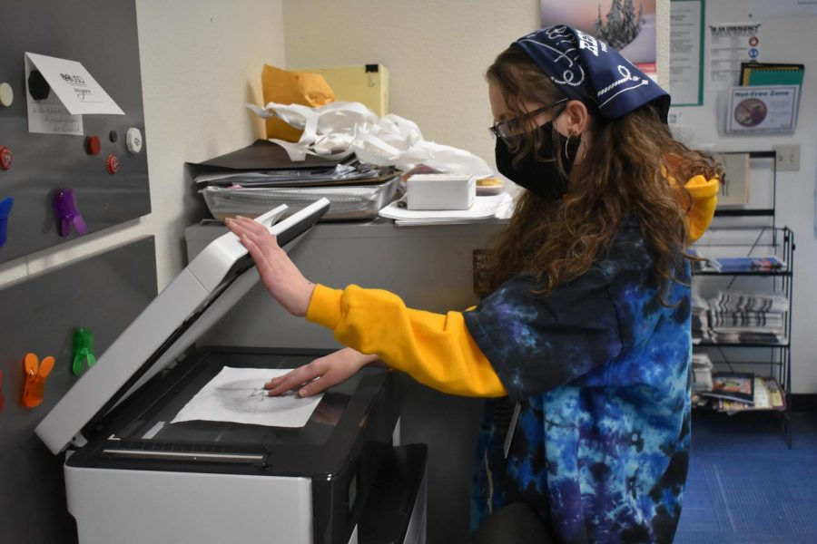 Aubrie Gilling, editor-in-chief of LitMag, photo copies a picture for the upcoming magazine. The magazine includes a variety of student stories, art pieces, poems, photos, and more, and will be available to purchase at the beginning of May.