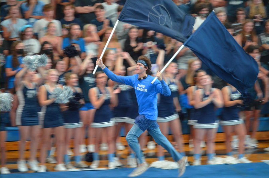 Party Starter: Adam Schwartz, a senior, opens the floor for the first pep rally of the year. Schwartz has been a part of Student Council since his freshman year. I love hyping up the crowd and getting them all riled up, said Schwartz